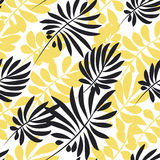 Modern plant pattern. Yellow and black tropical leaves seamless Royalty Free Stock Photo