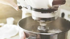 A modern plastic and metal mixer is whipping the cream stock photos