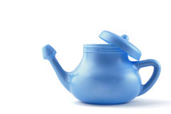 Modern Plastic Neti Pot. A modern plastic Neti Pot, used for nasal irrigation, a homeopathic remedy for sinus relief. Nasal irrigation has been practiced in Stock Images
