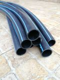 Modern plastic pipes for water from low-pressure polyethylene stock image