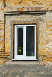 Modern plastic window on old brick wall Royalty Free Stock Photos