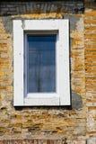 Modern plastic window on old brick wall Royalty Free Stock Photo