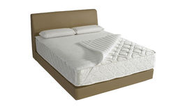 Modern platform bed. With mattress and pillow Royalty Free Stock Images