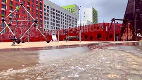 Modern playground with babbling brook for children stock video footage