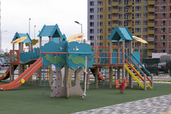 Modern Playground Equipment. Modern Colorful kids playground on yard in the park Royalty Free Stock Photos