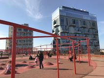 Modern playground with lots of activities and modern high rise buildings in the background. stock images
