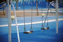 Modern playground with swings Stock Photos