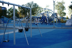 Modern playground with swings Royalty Free Stock Images