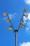 Modern pole with spotlights and blue sky stock images