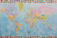Modern political world map backdrop. Modern political world map. Travel and geography background, planet atlas with countries flags set Royalty Free Stock Photos