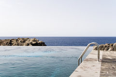 Modern pool. Beautiful Modern Swimming Pool at the sea coast Stock Photography