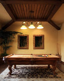 Modern pool game room. Pool game table takes center stage of this beautifully decorated pool room royalty free stock photo