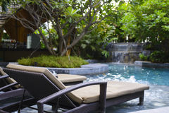 Modern pool with lounge chair Stock Photography