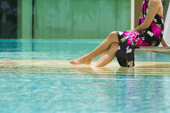 Modern pool and woman Royalty Free Stock Image