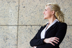 Modern portrait of a young professional business woman. Smiling and looking away Royalty Free Stock Image