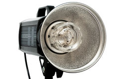 Photographic flash. Modern powerful photographic flash on a white background Royalty Free Stock Image