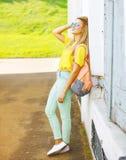 Modern pretty cool hipster girl enjoying summer posing Stock Photo