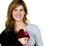 Modern Pretty Mom with Baby. Mother with her baby girl in a sling Royalty Free Stock Photo