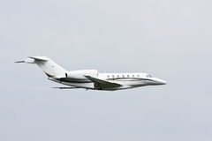 Modern private jet in flight. Sleek, modern private luxury jet in flight Royalty Free Stock Images