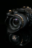 Modern profesionalny camera SLR. On the black background Royalty Free Stock Image
