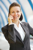 Modern professional businesswoman with phone. Very cute modern professional businesswoman royalty free stock photo