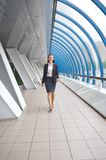 Modern professional businesswoman walking Stock Image