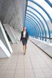 Modern professional businesswoman walking Stock Image