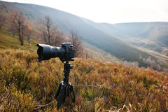 Modern professional dslr camera on a tripod, outdoor photography Stock Images