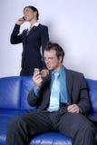 Modern professionals on phones Stock Photo