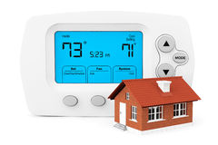 Modern Programming Thermostat with small home Royalty Free Stock Image