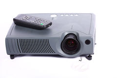 Modern projector with remote controller Stock Photography