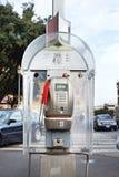 Modern public telephone on city street Royalty Free Stock Photography
