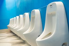 Modern public toilets Interiors A row of urinals urinating Royalty Free Stock Photography