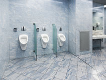 Modern public wc. Bright white and blue colors Stock Image