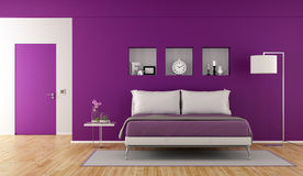 Modern purple bedroom Royalty Free Stock Photo