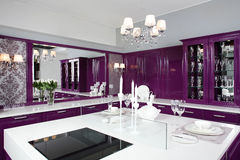 Modern purple kitchen with stylish furniture Royalty Free Stock Photography