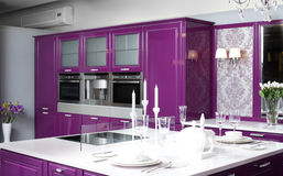 Modern purple kitchen with stylish furniture. Luxury purple kitchen interior with modern furniture royalty free stock images