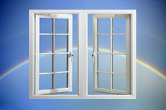 Modern pvc window floating in sky with rainbow Royalty Free Stock Images