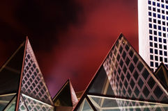 Modern pyramids. Glass pyramids, ultra-modern office building, and red sky Stock Image