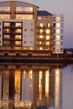 Modern Quayside Apartment Block. On Cardiff Bay reflecting the setting sun Royalty Free Stock Photography