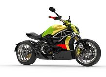 Modern race chopper bike - two tone green - yellow paintwork. Isolated on white background Stock Photo