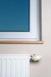Modern  radiator and window in home interior Stock Images