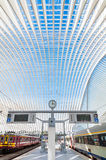 Modern railway station with transparent ceiling and blue sky Stock Photos