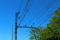 Modern railway wires. Against blue sky Royalty Free Stock Image