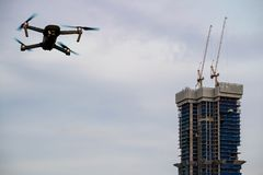 Crane and construction site building and drone Royalty Free Stock Images