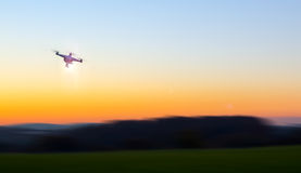 Modern RC UAV Drone / Quadcopter with camera flying on a clear s Royalty Free Stock Image
