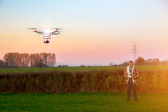 Modern RC UAV Drone / Quadcopter with camera flying on a clear s Royalty Free Stock Photography
