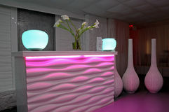 Modern Reception Desk. And area of a business, in a pink and blue color scheme Royalty Free Stock Photo