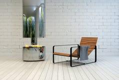 Modern reclinerstol nära en öppen brand Arkivbilder