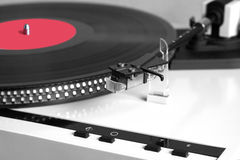 Modern record player with vinyl record closeup Royalty Free Stock Images